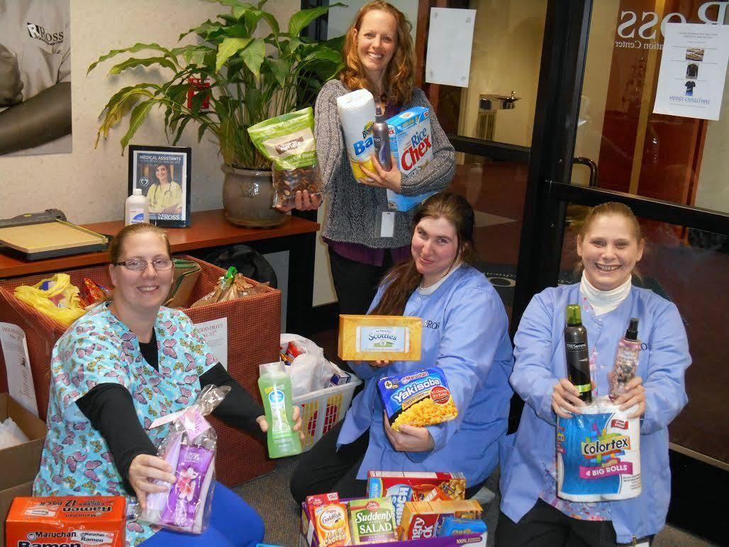 Students with Food from Ross Medical in Saginaw's Holiday Food Drive