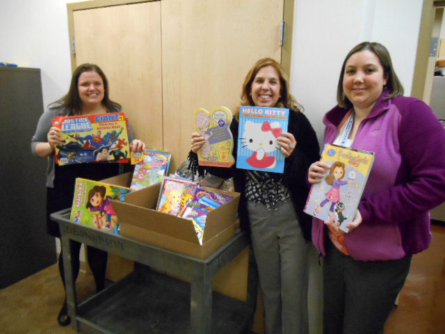 Ross Taylor staff organize coloring books and crayons